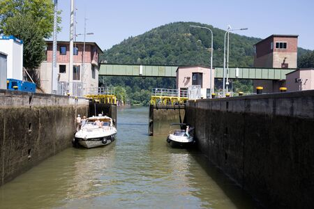 View on the Lock with Two Boats on the Neckar in Heidelberg Germany Photographed during a tour by ship on the Neckar in Germany