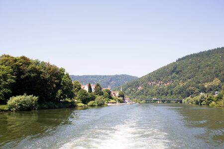 View on the tree area and nature along the Neckar river in Heidelberg Germany during a tour by ship on the Neckar in Germany