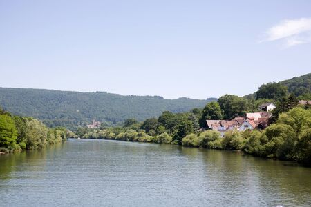 View on the landscape along the Neckar river in Heidelberg Germany during a tour by ship on the Neckar in Germany