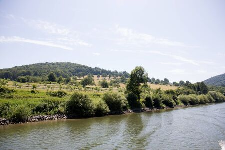Distant view on the Hill and Nature at the Neckar in Heidelberg Germany during a tour by ship on the Neckar in Germany