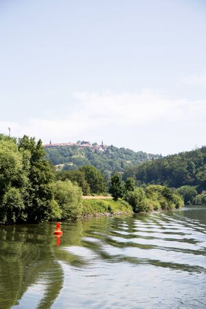 View on the Neckar in Heidelberg, Germany. Photographed during a tour by ship on the Neckar in Germany