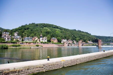 View on the landscape at the Neckar in Heidelberg Germany during a tour by ship on the Neckar in Germany Imagens