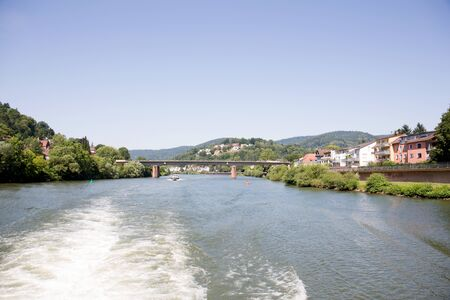 Distant view at the neckar in heidelberg germany photographed during a tour by ship on the neckar in germany