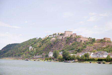 View of a rhine riverbank in rhine and surrounding mountains during a rhine riverbank cruise Stockfoto