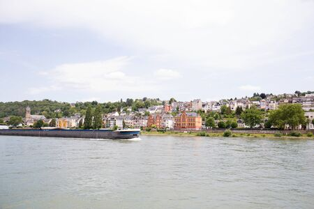 View on the building exterior at the rhine riverbank in Koblenz. Rhine and surrounding photographed during a sightseeing tour on the Rhine at a sunny day Stockfoto