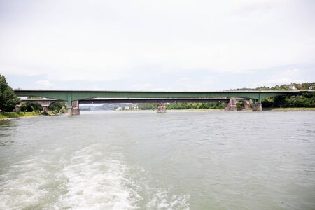 View on the bridge over the rhine river in rhine and surrounding photographed during a sightseeing tour on a rhine river at a sunny day