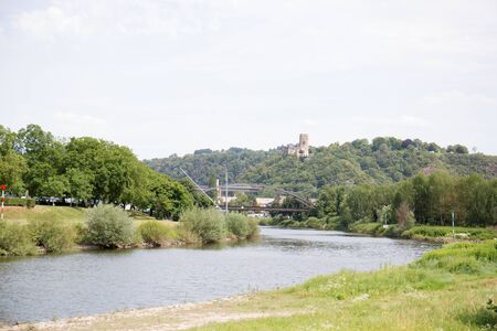 Closer view on the river and nature in Koblenz. Rhine and surrounding photographed during a sightseeing tour on a river on a sunny day