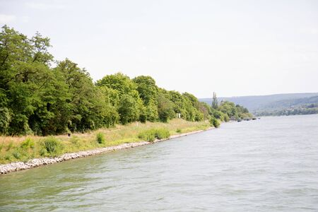 Closer view on the rhine riverbank in Koblenz. Rhine and surrounding photographed during a sightseeing tour on the Rhine at a sunny day