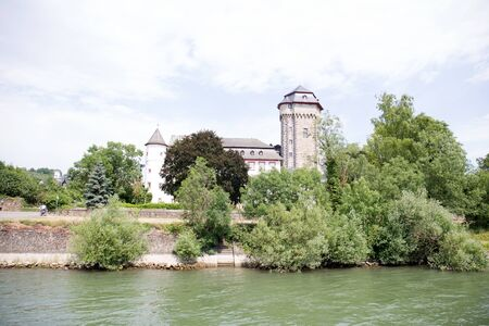 Closer view on a rhine riverbank in Koblenz. Rhine and surrounding photographed during a sightseeing tour on a rhine river at a sunny day