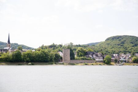 Closer view on the building exterior at the Rhine riverbank in Koblenz. Rhine and surrounding photographed during a sightseeing tour on a river on a sunny day