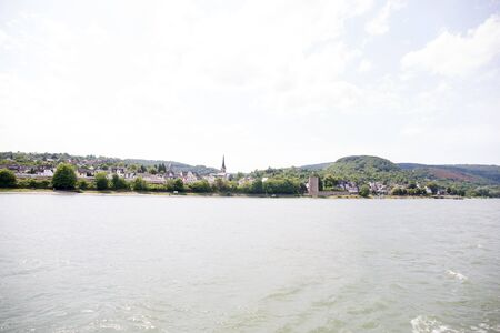 Distant view on hills at the rhine riverbank in Koblenz. Rhine and surrounding photographed during a sightseeing tour on a rhine river at a sunny day