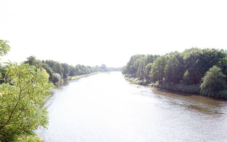 View along the river Ems in Lathen Emsland Germany photographed during a walk in the nature on a sunny day