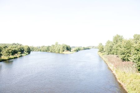 Distant view of the River Ems and the River Banks in Lathen Emsland. Germany. Photographed during a walk in the nature on a sunny day Stockfoto - 130277250
