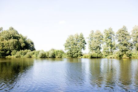 Distant view on the river on the river bank in lathen emsland germany photographed during a walk in the nature on a sunny day