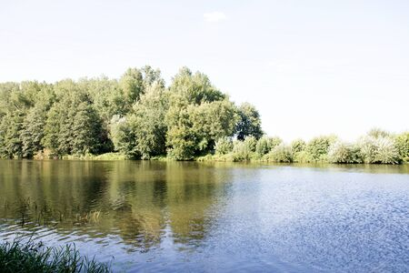 Distant view on the river Ems and the planned river bank in Lathen-Emsland Germany photographed during a walk in the nature on a sunny day