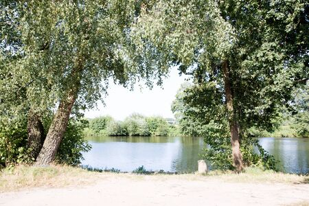 Distant view on the river through trees in laten emsland germany photographed during a walk in the nature on a sunny day