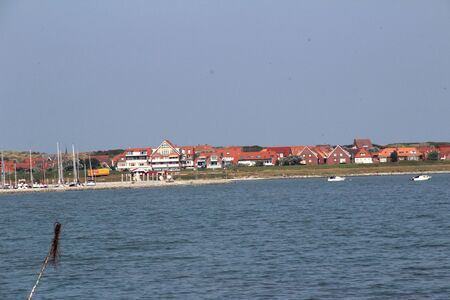 Distant view on the built structure of the South on the northern sea island Stockfoto