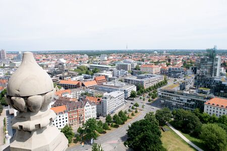 Distant view of the building from the tower of the new civil hall of hannover germany photographed during a walk at a cloudy sunny day Stockfoto