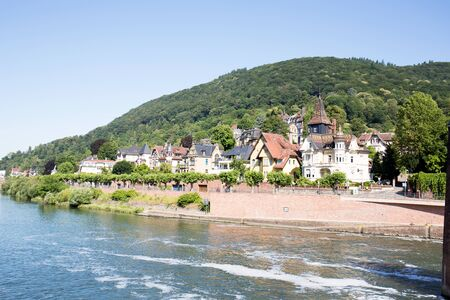 View on the buildings at the Neckar river in Heidelberg Germany during a tour by ship on the Neckar in Germany