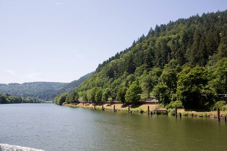 View on the hill at the Neckar river in Heidelberg. Photo taken during a tour by ship on the Neckar in Germany