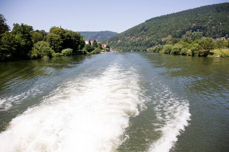Distant view on the moving water on the Neckar river in Heidelberg Germany. During a tour by ship on the Neckar in Germany Stockfoto - 131642212