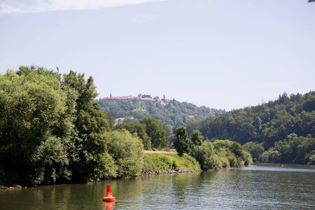 View on the natural landscape on the Neckar river in Heidelberg Germany during a tour by ship on the Neckar in Germany