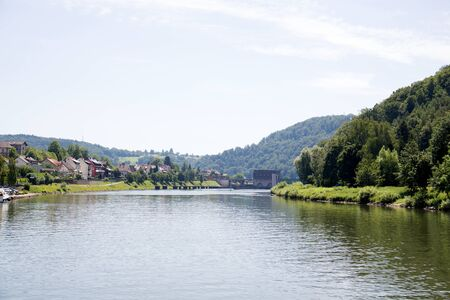 Distant view on the river Neckar river in Heidelberg Germany during a tour by ship on the Neckar river in Germany