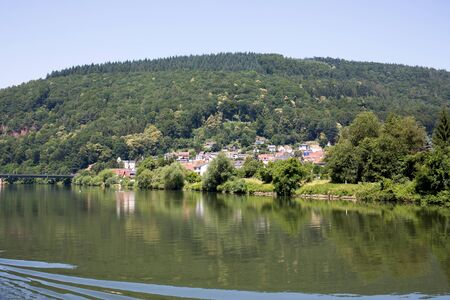 Distant view on the hill with a tree area on the river neckar in Heidelberg Germany. Photographed during a tour by ship on the Neckar in Germany Stockfoto