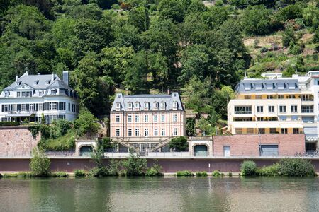 Closer view on buildings at neckar bank in heidelberg germany photographed during a tour by ship on the neckar in germany