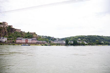 Distant view on the buildings near the rhine riverbank in koblenz germany Stockfoto - 133065235