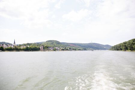 Distant view on the Rhine riverbanks and hills near Koblenz. Germany under blue sky