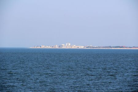 Distant view at the northern sea and the island juist under blue sky