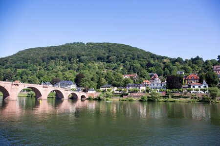 View on a historical bridge over the neckar in heidelberg germany