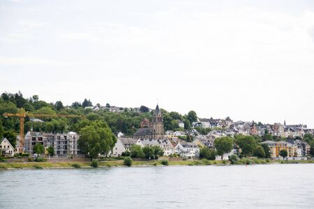 View on the building exterior at a hill at the rhine river in koblenz germany Stockfoto