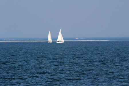 View on two sail boats in the background at the northern sea island juist germany