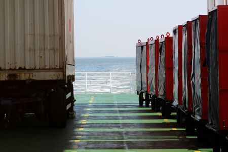 View through containers on a ship at the northern sea island juist germany Stockfoto