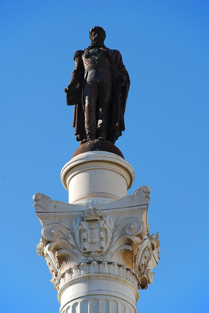Column of Pedro IV on Rossio Square, Lisbon, Portugal. Rossio Square is the popular name of the Pedro IV Square (Portuguese: Praca de D. Pedro IV) in the city of Lisbon, in Portugal Stock Photo