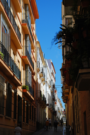 Typical small street in Cadiz, Spain. Cadiz is a city and port in southwestern Spain and the capital of the province of Cadiz Stock Photo