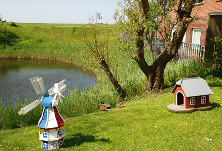 Garden scene on the Warft on the Hallig Hooge in north Friesland. The Halligen (singular Hallig) are ten small German islands without protective dikes in the North Frisian Islands on Schleswig-Holstein's Wadden Sea-North Sea coast in the district of Nordfriesland