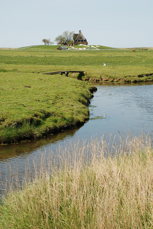 A ditch on the Hallig Hooge, Germany. The Halligen (singular Hallig) are ten small German islands without protective dikes in the North Frisian Islands on Schleswig-Holstein's Wadden Sea-North Sea coast in the district of Nordfriesland