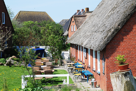 Dwellings on the Warft on the Hallig Hooge in north Friesland. The Halligen (singular Hallig) are ten small German islands without protective dikes in the North Frisian Islands on Schleswig-Holsteins Wadden Sea-North Sea coast in the district of Nordfriesland