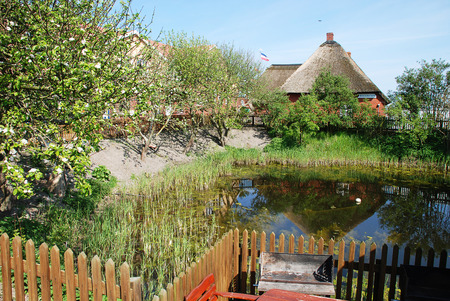 Garden scene on the Warft on the Hallig Hooge in north Friesland. The Halligen (singular Hallig) are ten small German islands without protective dikes  in the district of Nordfriesland