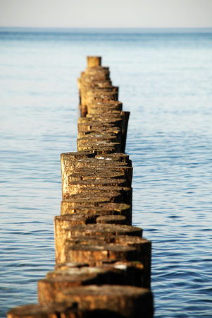 Coast protection at the baltic sea (Kuehlungsborn, Germany): groynes.  In the ocean, groynes create beaches or prevent them being washed away by longshore drift. Standard-Bild