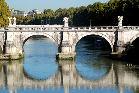 Ponte SantAngelo, once the Aelian Bridge or Pons Aelius, meaning the Bridge of Hadrian, is a Roman bridge in Rome, Italy, to span the Tiber, from the city center to his newly constructed mausoleum, now the towering Castel SantAngel