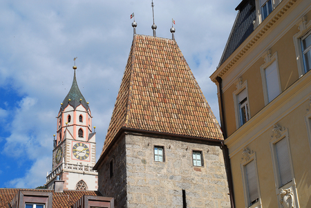 Meran, South Tyrol, Italy: The tower of St. Nicholas' Church and the Bozener Tor (Bozen Gate)