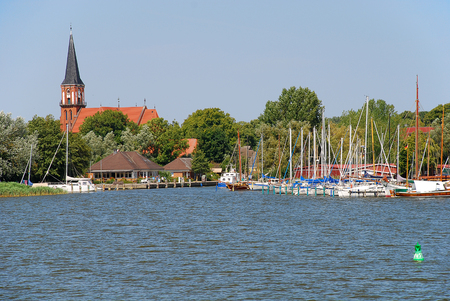Harbor and church in Wustrow. Wustrow is a municipality at Baltic Sea coast in Mecklenburg-Vorpommern, Fischland, Germany