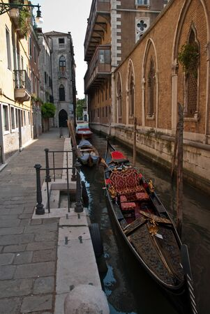 Venice, Italy: Canal with two gondolas in Venice, Architecture and landmarks of Venice