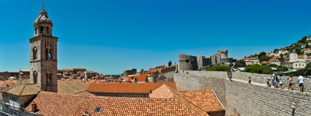 Rooftops in Dubrovniks Old City with the city wall and the Dominican monastery, which is one of the most important architectural parts of Dubrovnik and major treasury of cultural and art heritage in Dubrovnik Imagens
