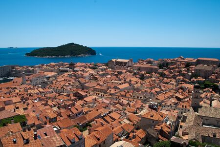 View over the roofs of Dubrovniks old city and the island Lokrum. Dubrovnik is a Croatian city on the Adriatic Sea. It is one of the most prominent tourist destinations in the Mediterranean Sea