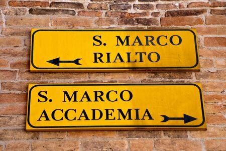 Venice, Italy: Fingerpost to the attractions St Marks Square (San Marco), Rialto Bridge (Ponte di Rialto) and Accademia bridge (Ponte dellAccademia) 写真素材